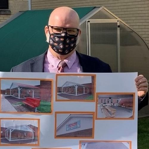 Dennis Peachey, Superintendent, Towanda Area School District, holding a rendering of the outdoor classroom.
